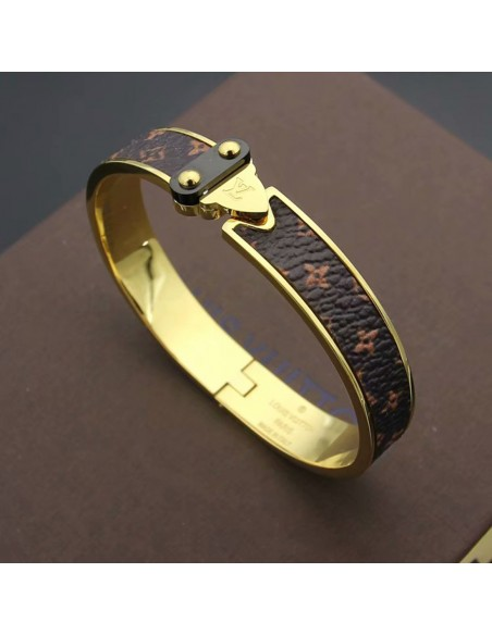 Brazalete acero oro Louis Viutton con relieve